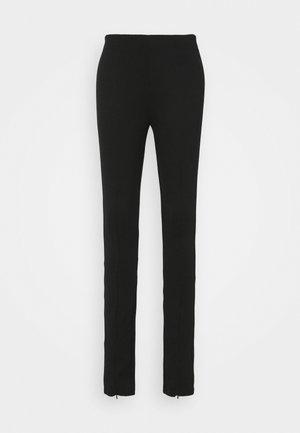 NORAH - Trousers - black