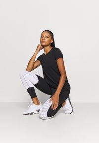 Puma - STUDIO KEYHOLE TEE - Basic T-shirt - black - 1