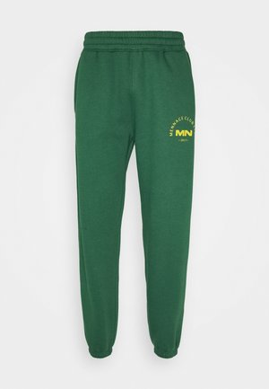 MENNACE CLUB UNISEX - Tracksuit bottoms - green