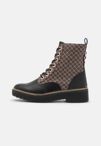 Platform ankle boots - brown/dark