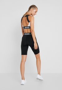 Reebok - Leggings - black - 2