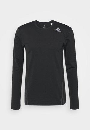 AERO - Funktionsshirt - black