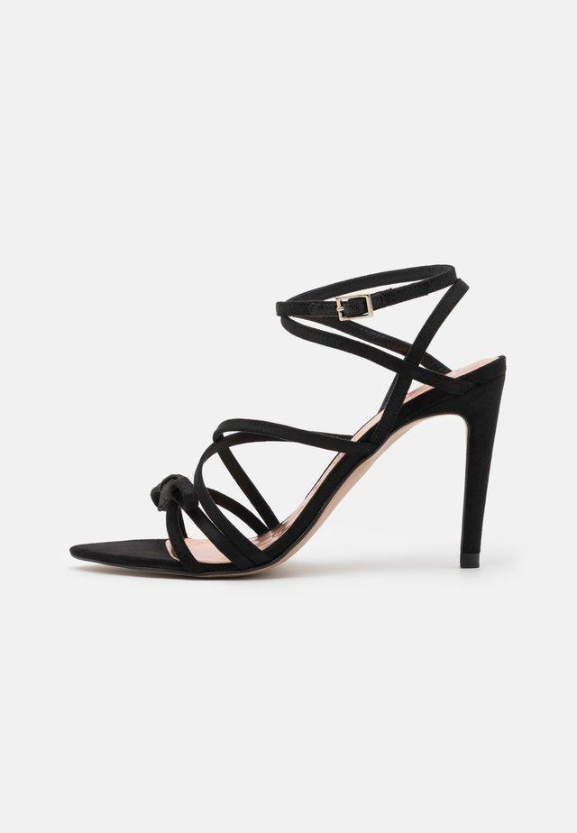 RELANA - Sandales - black