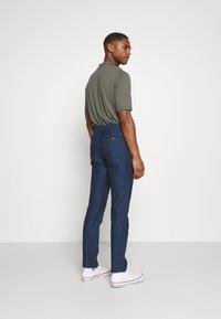 Tommy Hilfiger Tailored - DENTON HERRINGBONE - Trousers - desert sky - 2