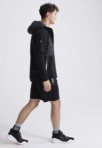 Superdry - Sports shorts - black - 1