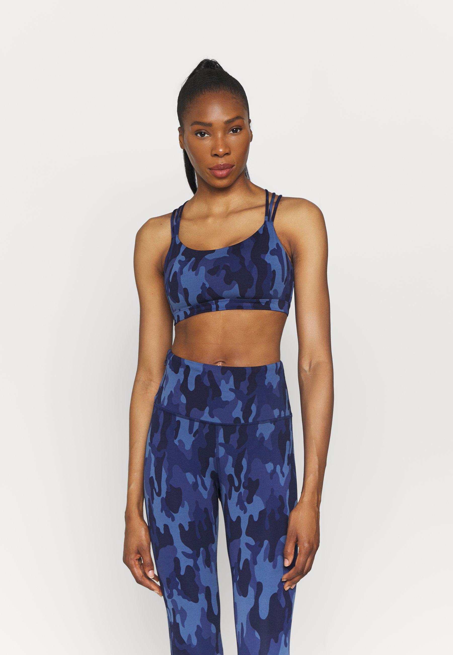 Women ECLIPSE STRAPPY BACK - Medium support sports bra - blue