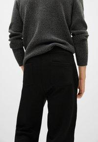 Mango - MARCIANO - Trousers - black - 4