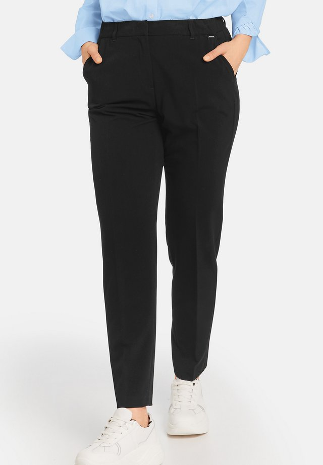 GRETA - Trousers - black