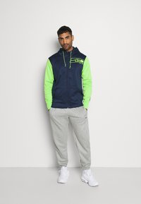 Nike Performance - NFL SEATTLE SEAHAWKS LEFT CHEST MASCOT FULL-ZIP THERMA HOOD - Klubové oblečení - college navy/action green - 1