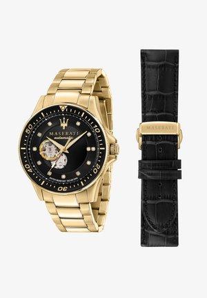 Horloge - gold/schwarz
