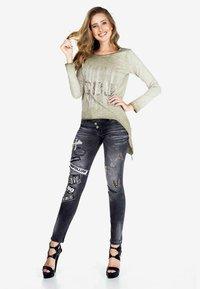 Cipo & Baxx - Slim fit jeans - black - 1