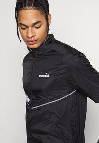 Diadora - LIGHTWEIGHT WIND JACKET BE ONE - Sports jacket - black - 4