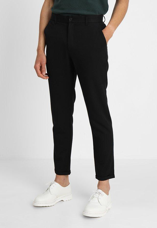 UGGE - Chino kalhoty - black
