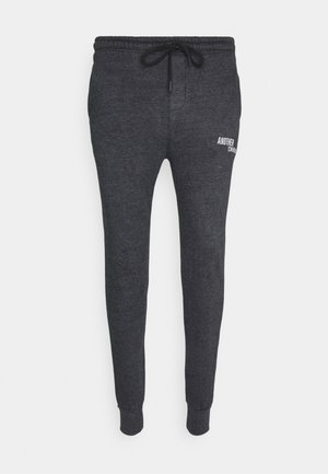 TOM JOGGER - Tracksuit bottoms - black