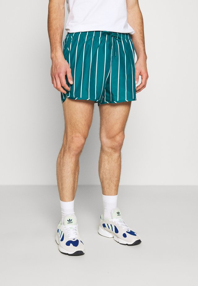 STRIPED SWIM - Swimming shorts - petrol green/white