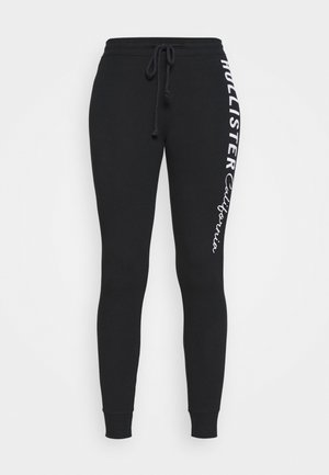 LOGO FLEGGINGS - Legginsy - black