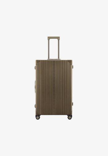 TRAVELER  - Wheeled suitcase - bronze