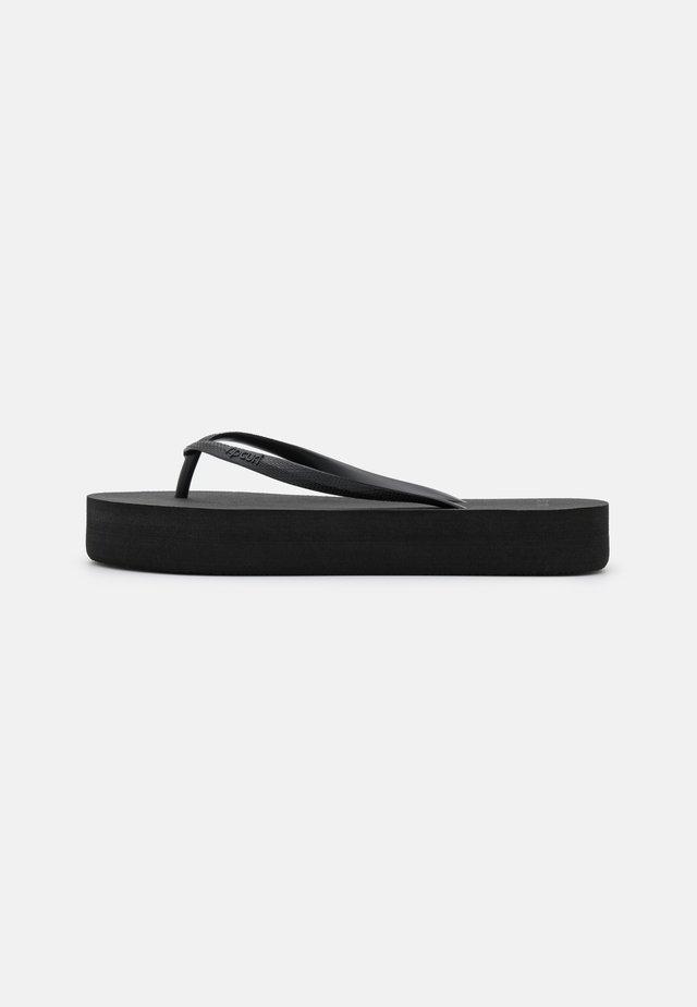 FRANKIE - T-bar sandals - black