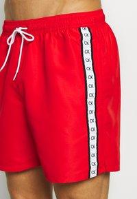 Calvin Klein Swimwear - MEDIUM DRAWSTRING - Swimming shorts - red - 3