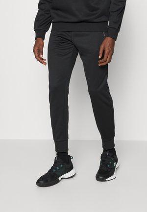 PANT TAPERED - Träningsbyxor - black