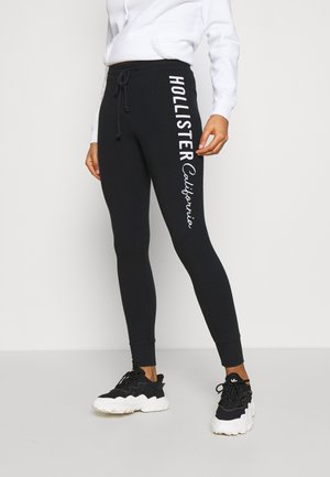 LOGO FLEGGINGS - Leggings - black