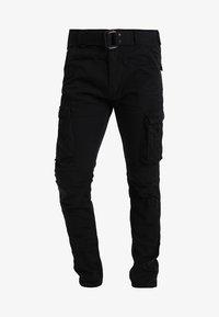 Schott - TRRANGER - Cargo trousers - black - 5