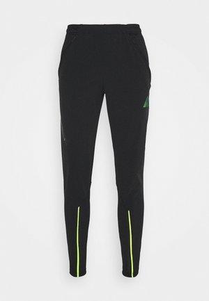 MERC DRY  - Pantalones deportivos - black/volt/volt