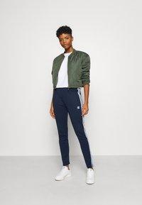 adidas Originals - PANTS - Tracksuit bottoms - collegiate navy/white - 1