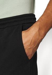 Calvin Klein Jeans - MICRO BRANDING PANT - Träningsbyxor - black - 5