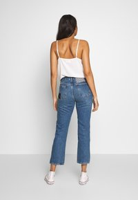 Free People - POPPY PATCH - Bootcut jeans - blue - 2