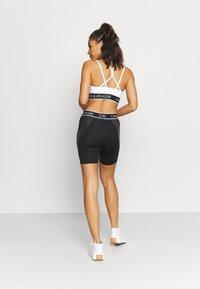 Calvin Klein Performance - CYCLIST LENGTH - Leggings - black - 2