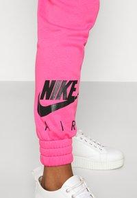 Nike Sportswear - AIR PANT   - Tracksuit bottoms - pinksicle/black - 3