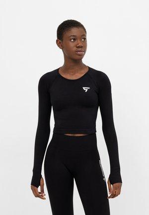 LONG SLEEVE RUSH+ SEAMLESS CROPPED LONG SLEEVE  - Sports shirt - black
