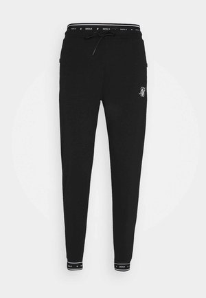 ACTIVE MUSCLE FIT - Tracksuit bottoms - black