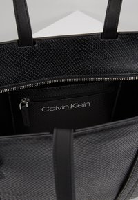 Calvin Klein - WINGED MED - Handbag - black - 4