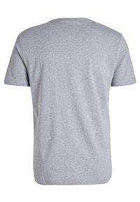 Puma - REBEL - T-shirt con stampa - medium gray heather - 1