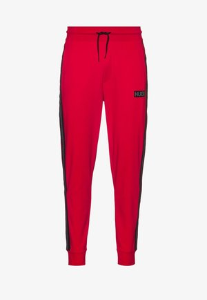 DONBURI - Tracksuit bottoms - red