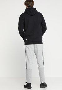 adidas Performance - MUST HAVES SPORT TIRO SLIM FIT PANT - Pantalon de survêtement - medium grey heather/black - 2