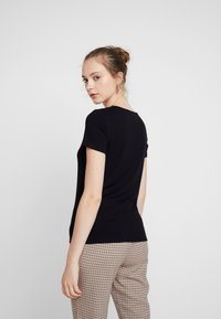 Vero Moda - VMANJA - Print T-shirt - black - 2