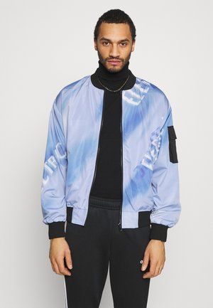 COOMBE REVERSIBLE UNISEX - Bomber bunda - black/blue