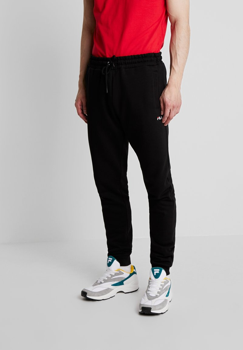 Fila - EDAN PANTS - Tracksuit bottoms - black