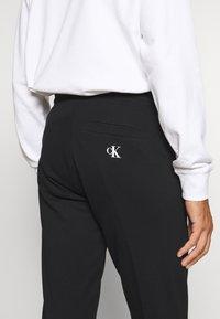 Calvin Klein Jeans - PANT - Tracksuit bottoms - black - 3