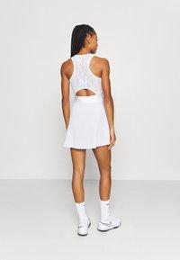 Nike Performance - MARIA DRESS - Sports dress - white/black - 2