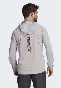 adidas Performance - TERREX AGRAVIC RAIN JACKET - Sports jacket - white - 4