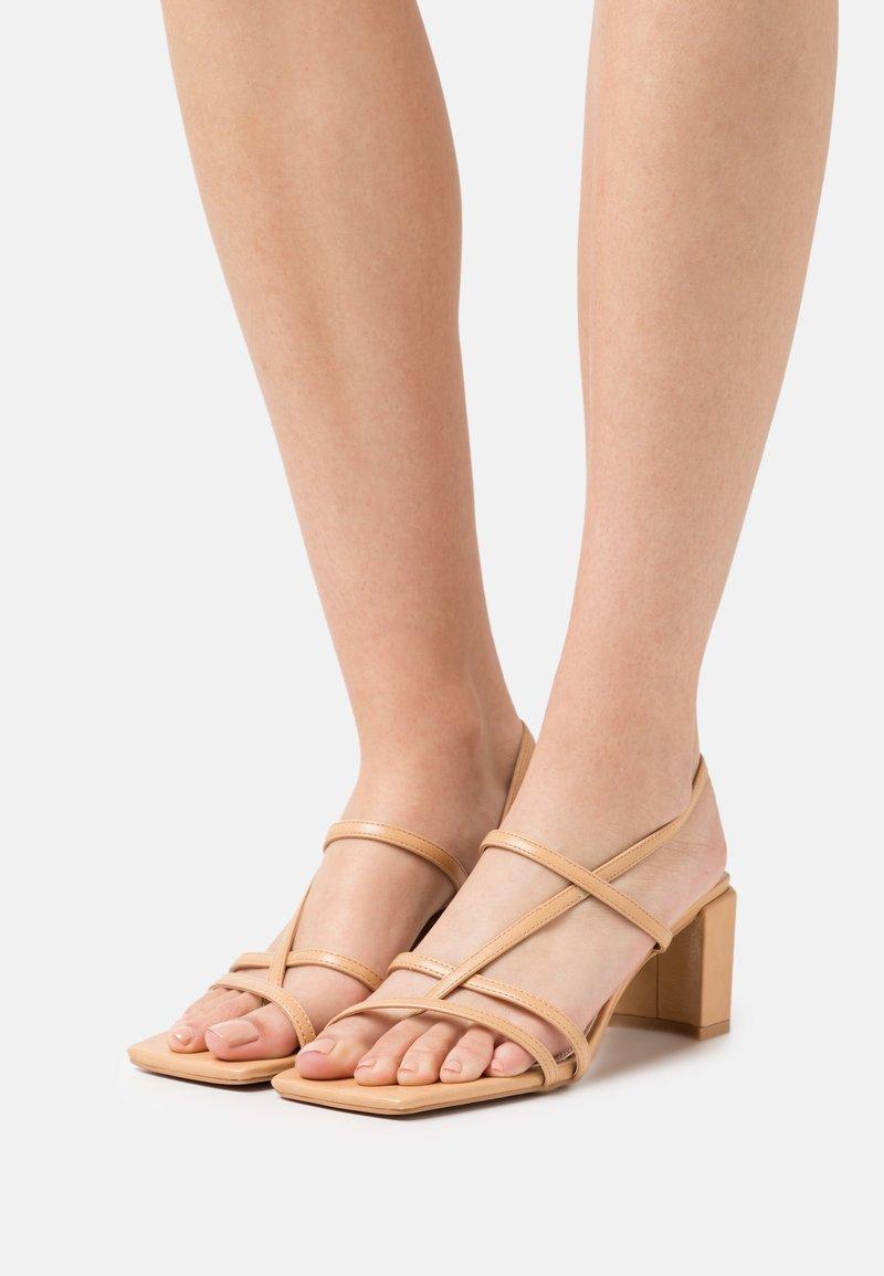 NA-KD - T-bar sandals - beige
