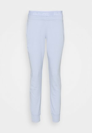 LOGO - Tracksuit bottoms - light blue