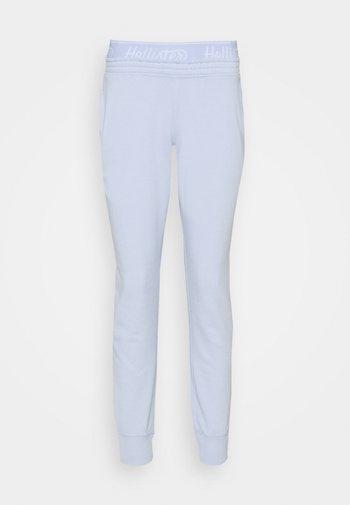 LOGO - Tracksuit bottoms - light blue