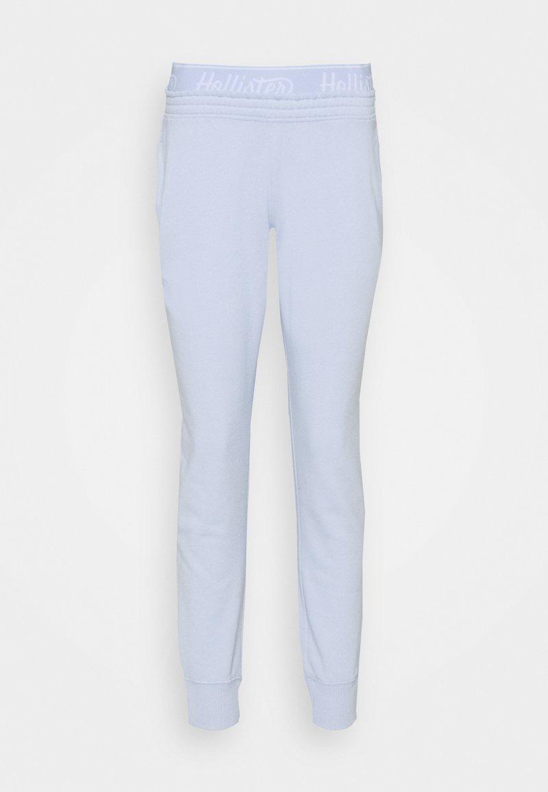 Hollister Co. - LOGO - Tracksuit bottoms - light blue