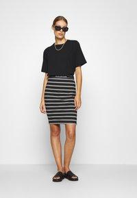 Calvin Klein Jeans - LOGO STRIPE MILANO SKIRT - Pencil skirt - black/creamy white - 1