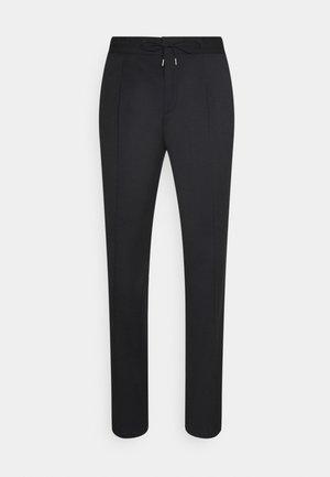 HELIOS - Trousers - black